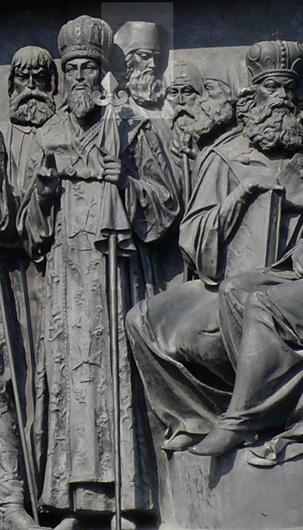 Тихон Задонский на Памятнике 1000-летия Росси» в Великом Новгороде. Тихон стоит в глубине, его лицо выделено светлым квадратом
