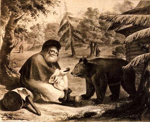Серафим угощает медведя