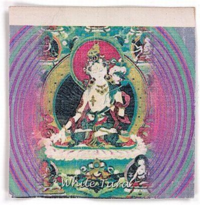 Марка (промокашка, пропитанная ЛСД) с картинкой, на которой изображена Белая Тара, буддийское божество