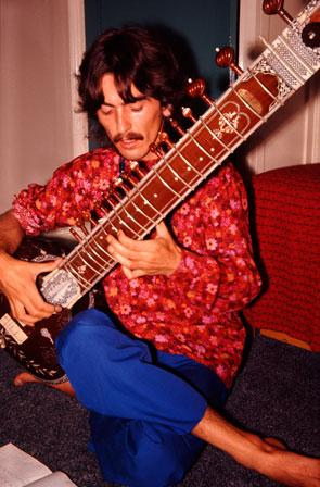 George Harrison playing sitar