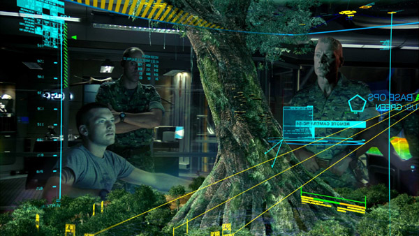 Кадр из фильма Аватар. Слева главный герой фильма Джейк Салли (Сэм Уортингтон), справа полковник Майлз Куоритч (Стивен Лэнг), глава всех вояк на Пандоре. Рассматривают компьютерную модель священного дерева туземцев Пандоры